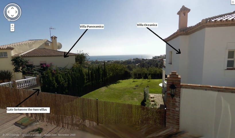 Photo showing the two villas next to each other and separated by a gate