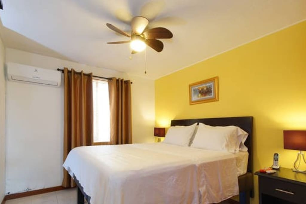 Air Conditioning, QUEEN bed, Flat TV screen.