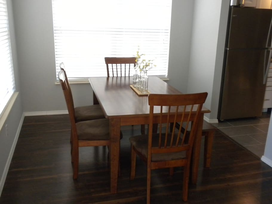 Dining table right off the kitchen perfect dining or family game night!