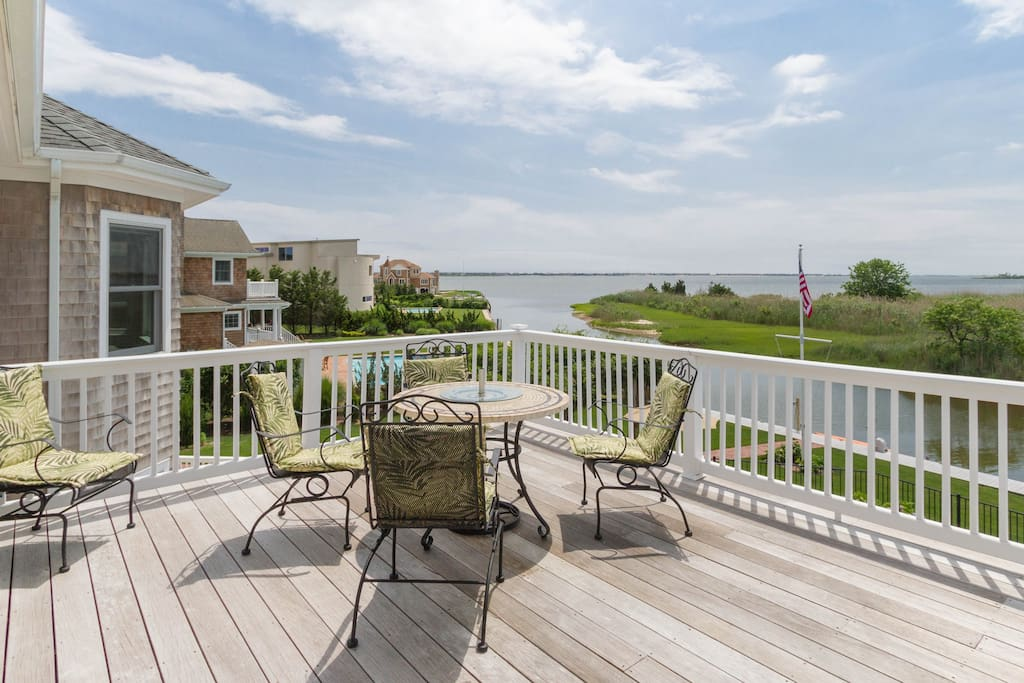 """Your own private large deck overlooking pool, and bay. """"We enjoyed having coffee out on the private balcony each morning, and drinking wine out there and watching the sunset. It exceeded all of our expectations."""""""