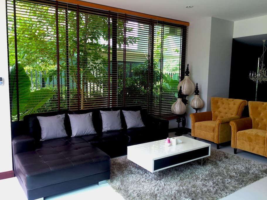 Big living room with greeny garden view