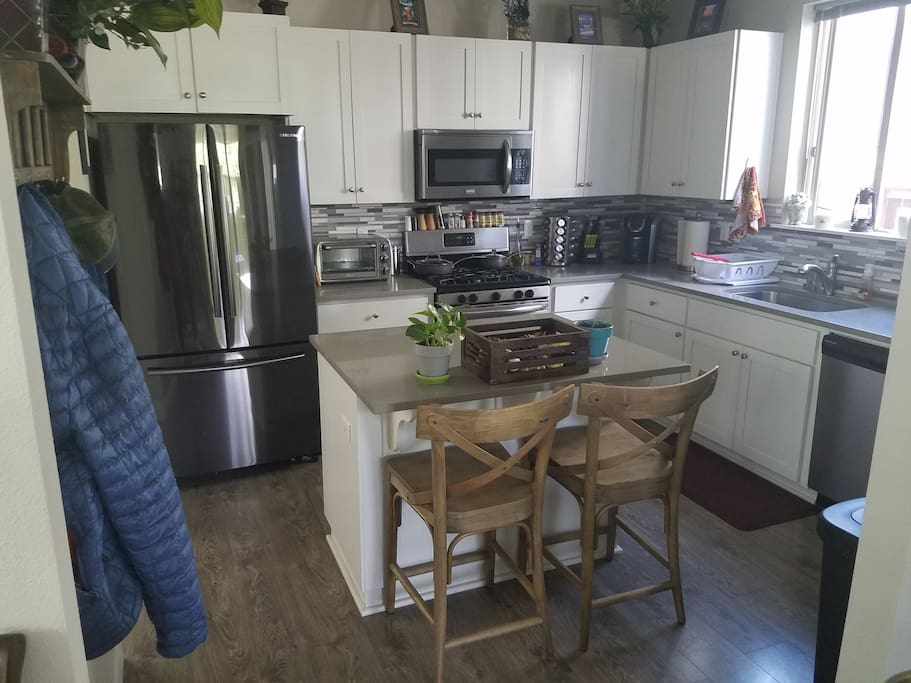 Shared kitchen with full ammenities including coffee maker and most applinces