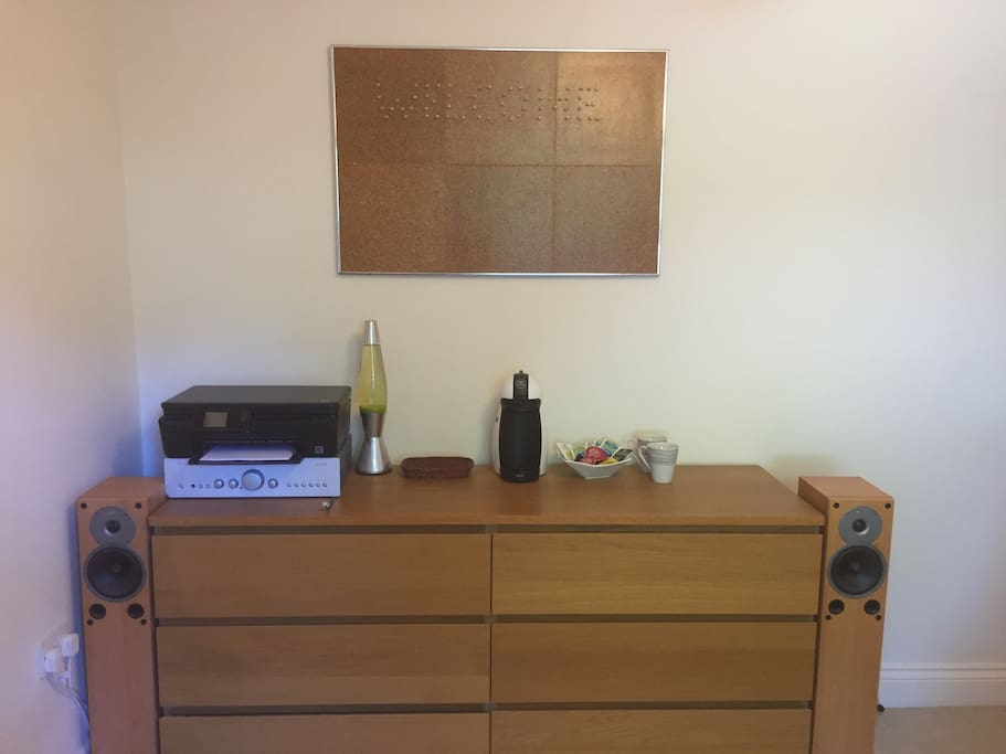 6 large chest of drawers, Hi-Fi and speakers (3.5mm jack for iPods etc), tea and coffee maker which also dispenses hot and cold water.