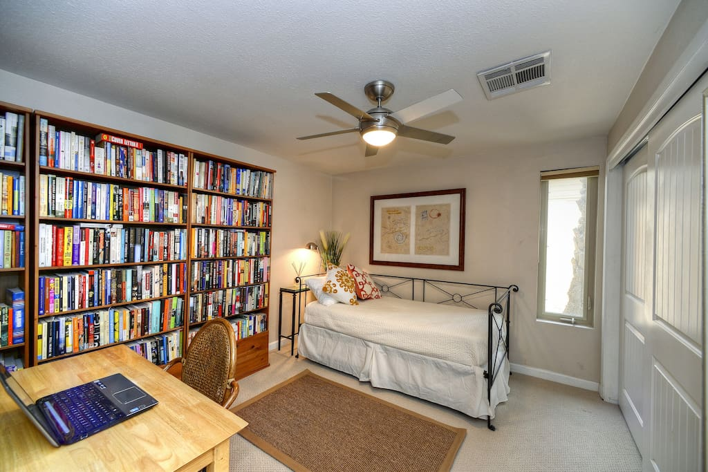 Guestroom with desk and large closet.