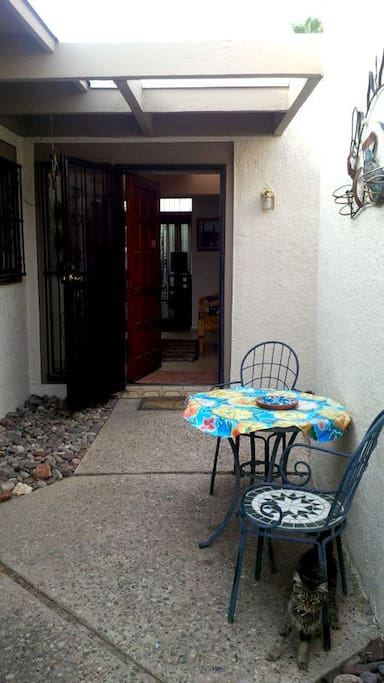 Front entry door with patio sitting area
