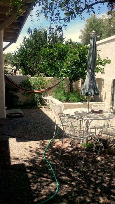 Back patio with hammock and seating area