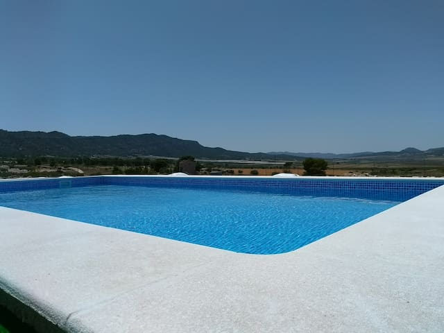 Our lovely pool with fantastic mountain views