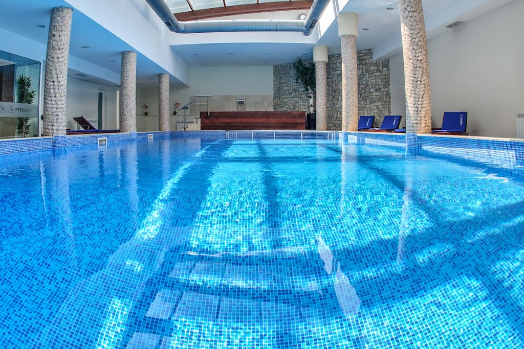 Swimming pool with panoramic sun roof