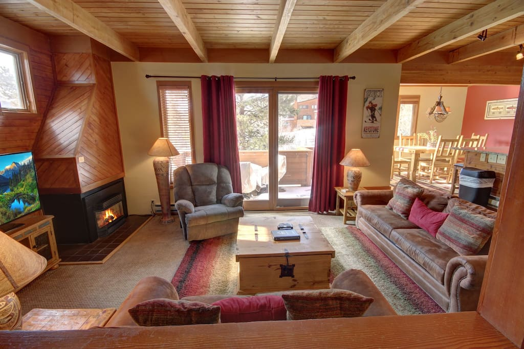 Cozy up to the fireplace after a long afternoon of skiing with the family and watch your favorite movie.