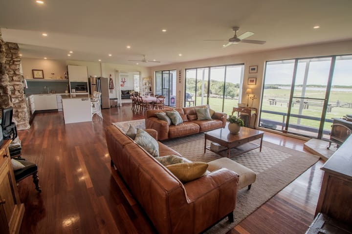 Newly renovated kitchen and spacious open-plan living spaces with breathtaking views of the lake (Belfast Lough) and dunes of Port Fairy's East Beach.