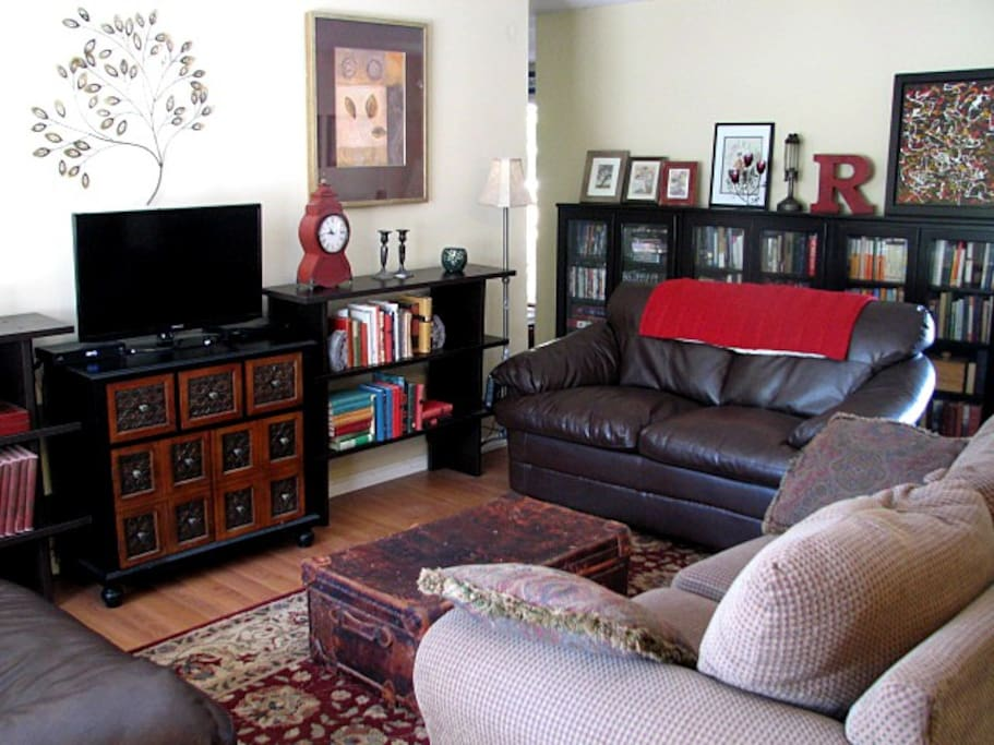 Living room with comfortable seating, lots of books, games, TV, cable, DVDs/player and WiFi.