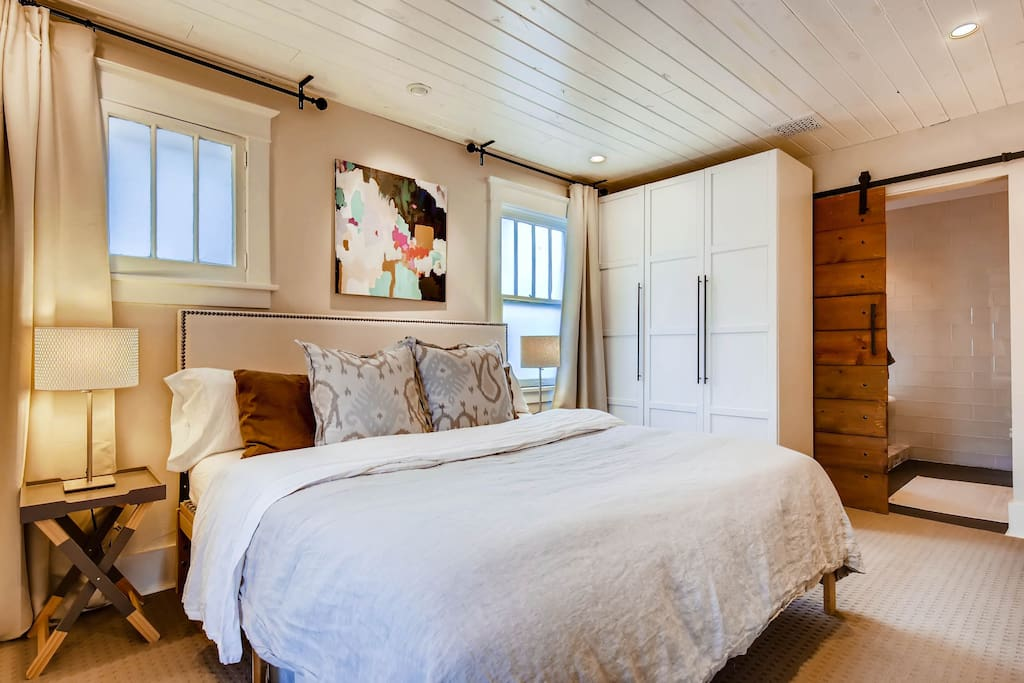 Master bedroom with King sized bed, Restoration Hardware linens.