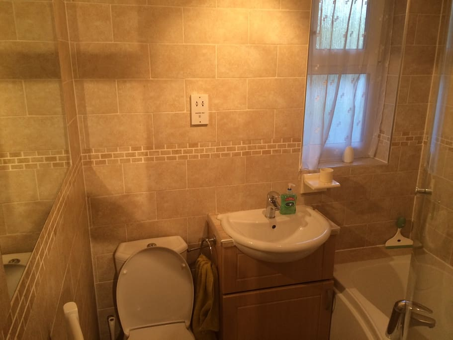 Full bathroom with bath and shower.