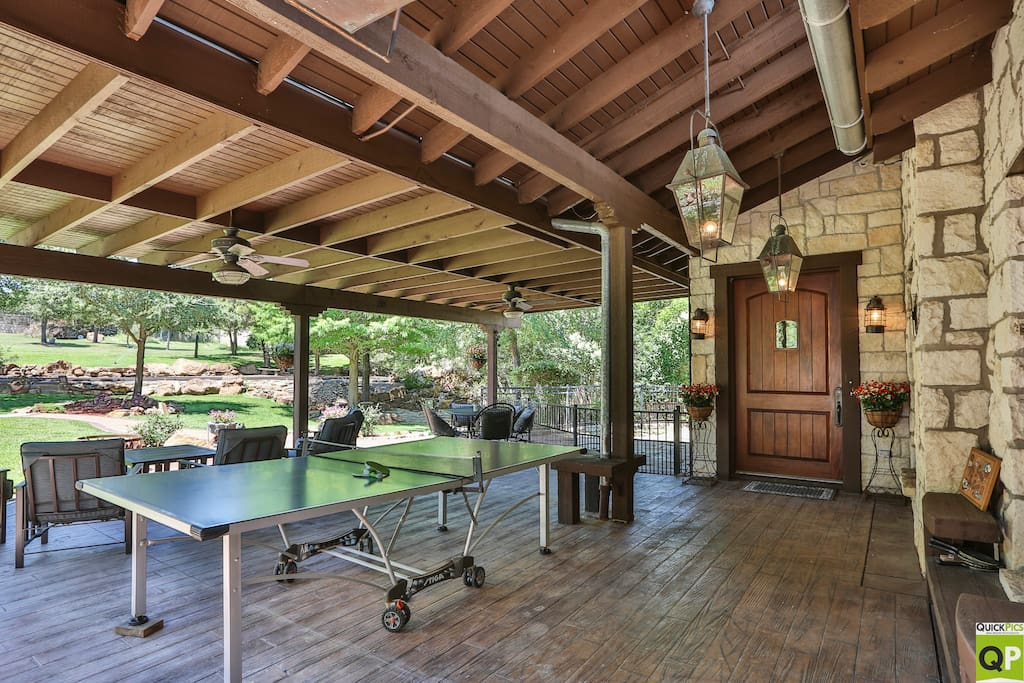 Front porch area has  comfortable chairs with coffee table overlooking front yard.  Table seats 6.
