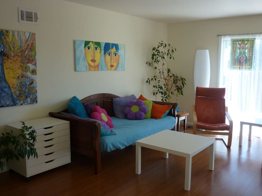 Cozy daybed/sofa in light filled colorful living room