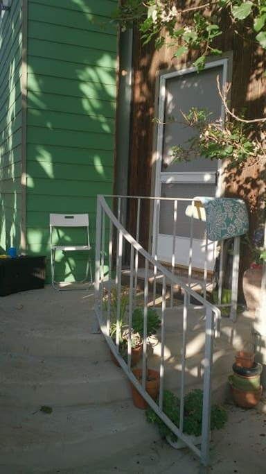 Front porch with succulent plants and handrail