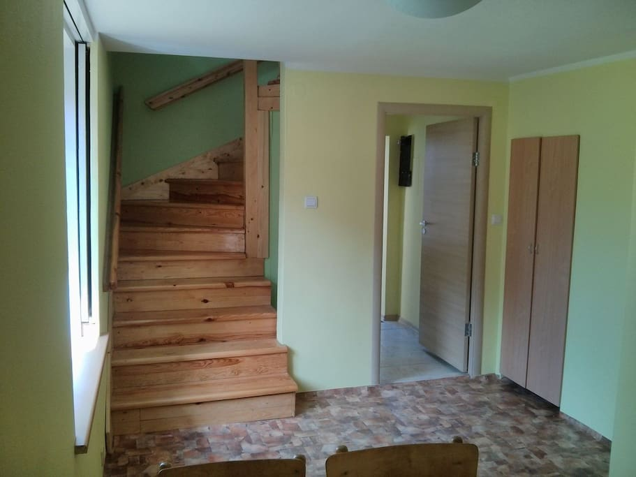 Kitchen and stairs to bedroom and dining room