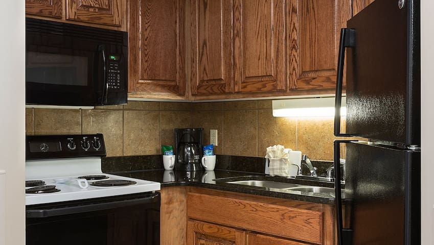 Full size private kitchen with full size stove and microwave