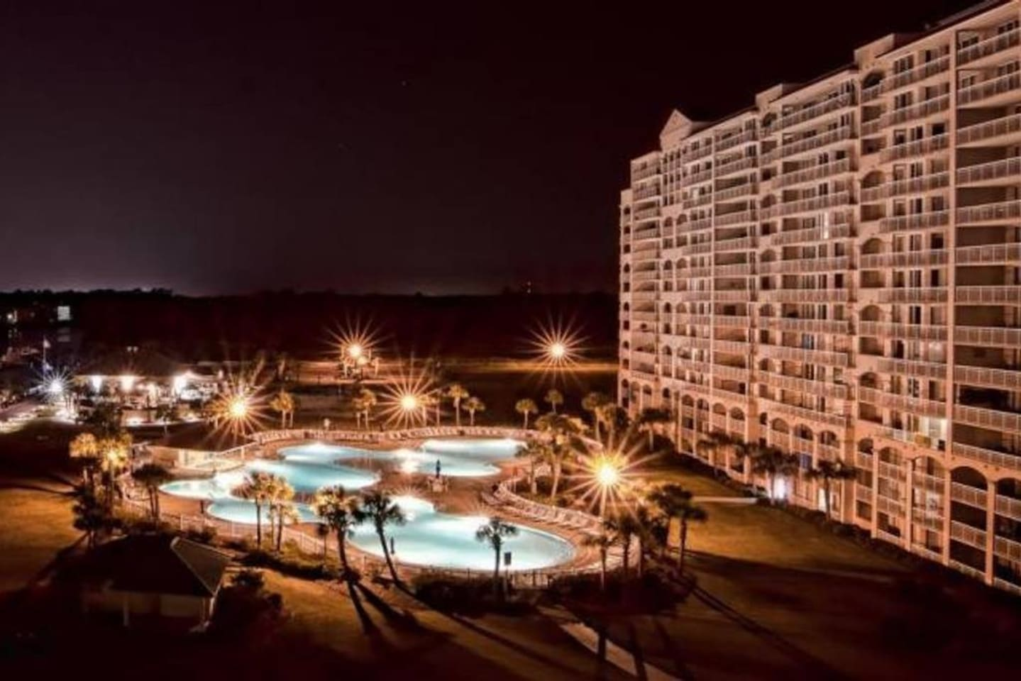 Beautiful pool from the balcony...night time is perfect with this view