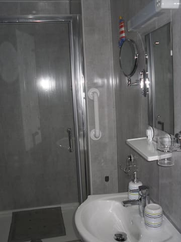 Large spacious enclosed shower in the En-suite. Shaving point available with magnifying mirror.
