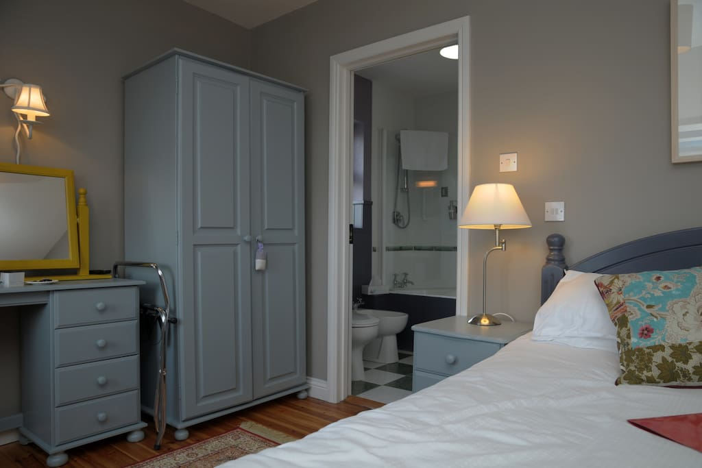 Spacious Double Bedroom with entrance to ensuite bathroom with bathtub