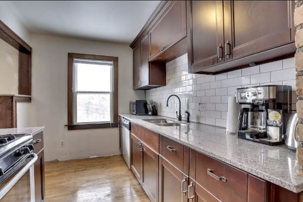 Kitchen remodeled in 2014 with new stainless steel appliances and granite countertops with dishwasher
