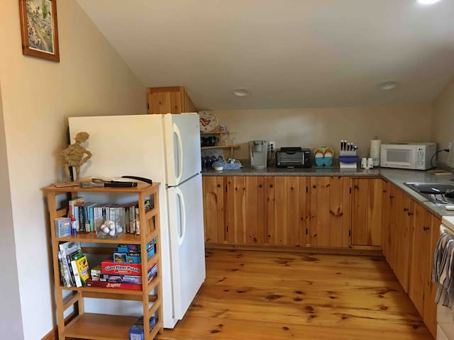 Fully stocked kitchen with toaster, Keurig, microwave, and more