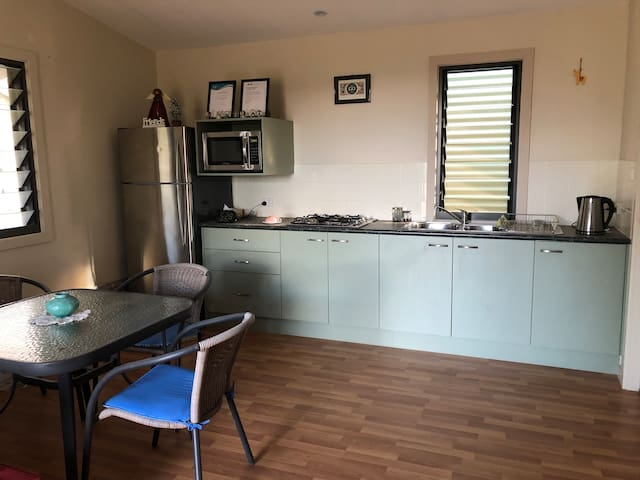 Microwave, gas stovetop in a Large living / dining and Kitchen area