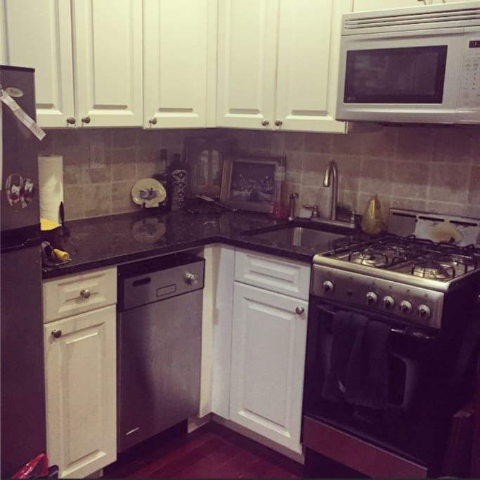 Full kitchen w/granite tops, including gas stove, microwave, fridge & dishwasher.