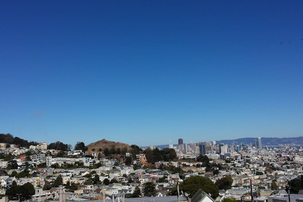 Beautiful view of SF skyline, Corona Park, and Buena Vista Park, visible from our front deck, living room, and dining room.