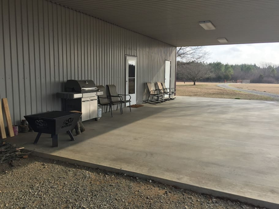 Plenty of space to relax on front porch with gas grill and fire pit. Firewood on site.