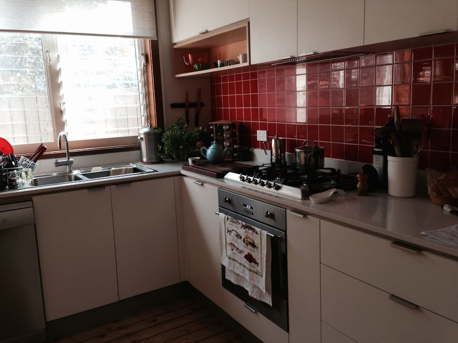 Recently-renovated kitchen, with gas cooktop, dishwasher, new fridge.