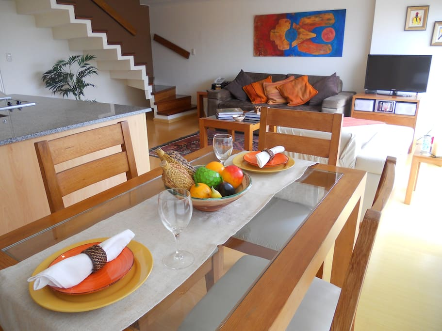 Large and bright living-dining room with panoramic ocean view.