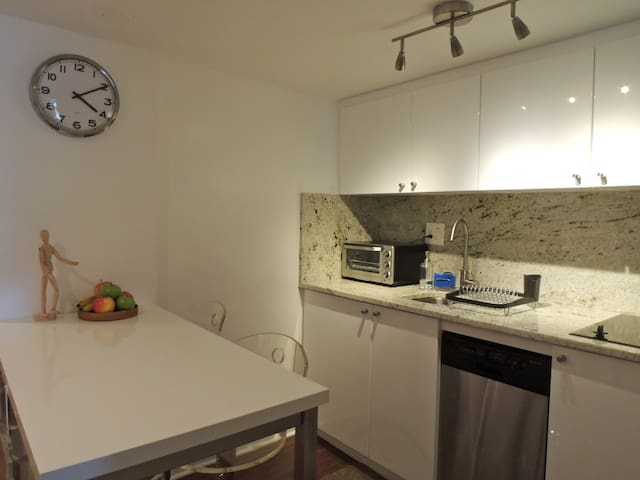 Full equipped kitchen with 2 burner electric stove, M/W, small D/W, mini fridge and counter top oven and toaster.