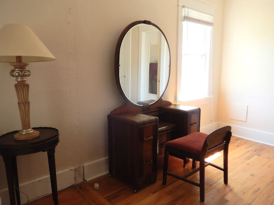 The bedroom features antique Waterfall furnishings including this vanity.