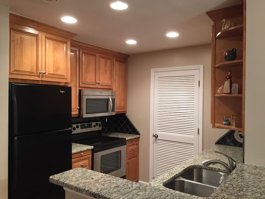Completely new kitchen with new washer and dryer in laundry room