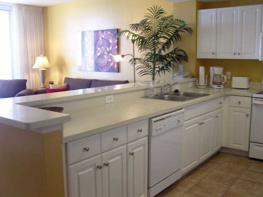 Open Concept! This stocked kitchen overlooks LR, balcony and ocean!