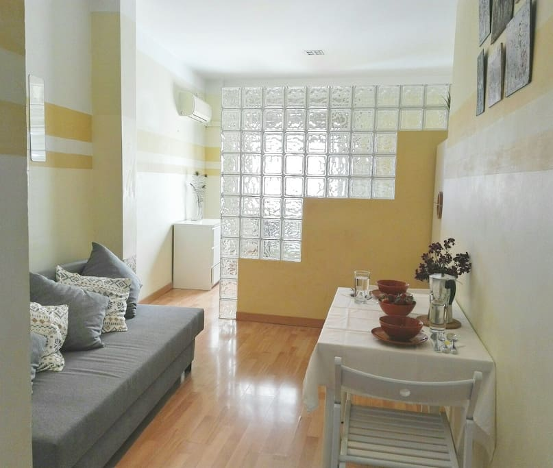 living room with Double sofa bed and dining area suitable for 3 people.