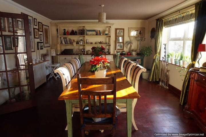 Spacious farm-house style kitchen and dining room, seats 10.