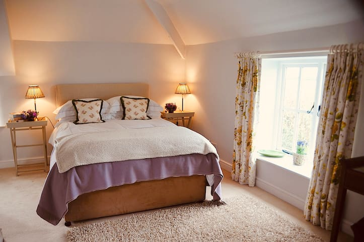 The Yellow Room - set up as a double. There is an ensuite bathroom with loo, basin and shower