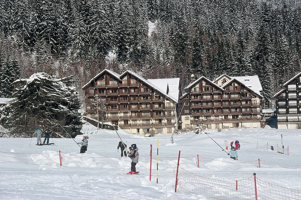 Savoy piste in the winter with Clos buildings in the distance
