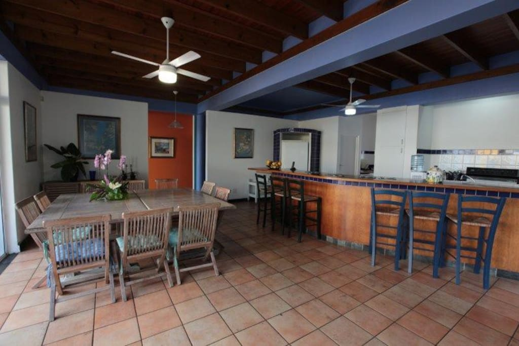 Open plan dining and kitchen area leading to patio with seaview