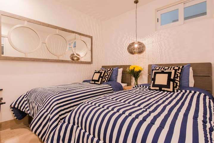 2nd bedroom - 2 single beds with comfortable mattresses and luxury bedding.