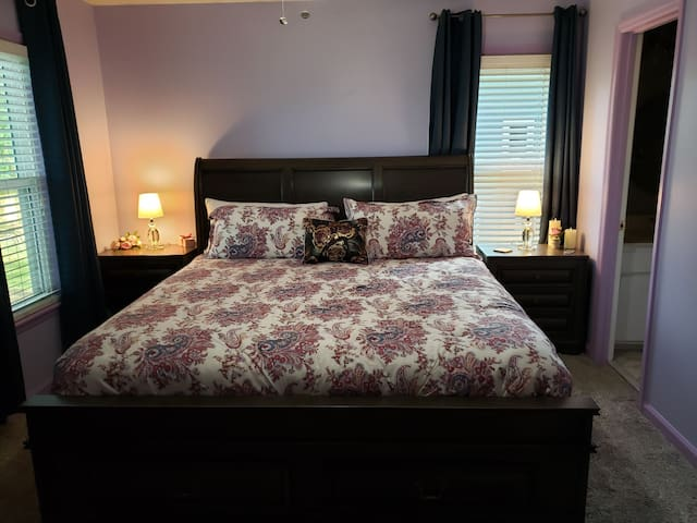 King bed in a Lavender bedroom.