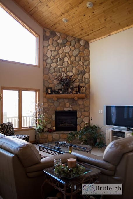 Living Room with Vaulted Ceilings and Electric Fireplace.