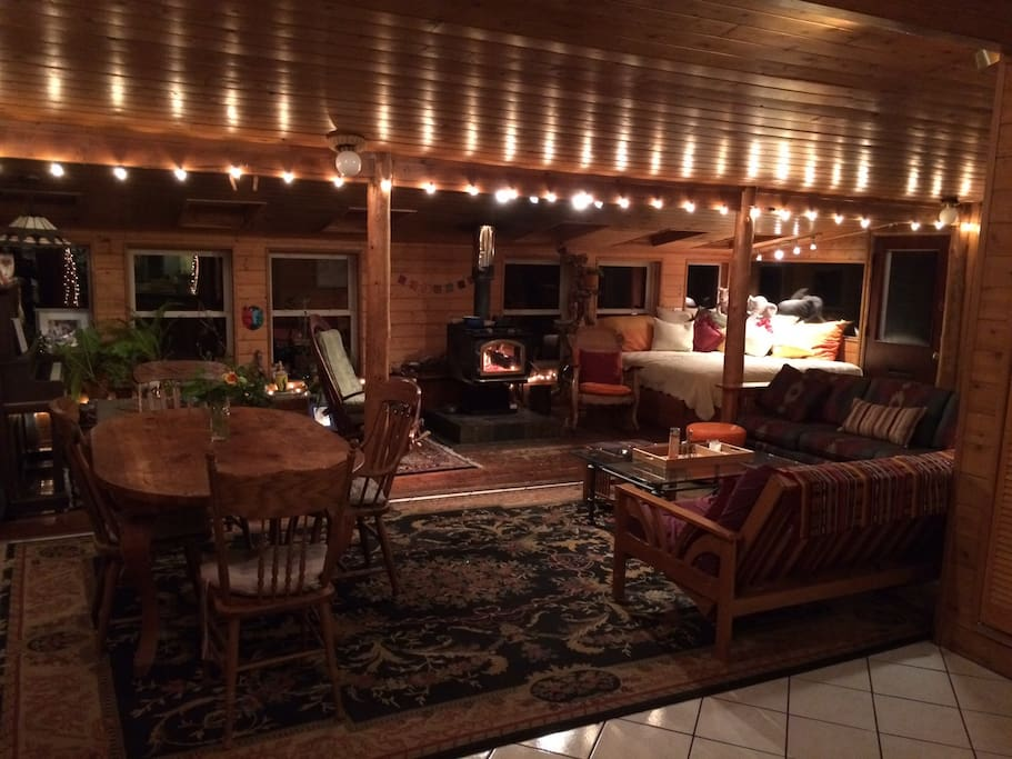 You get full access to the living room with rustic local log posts