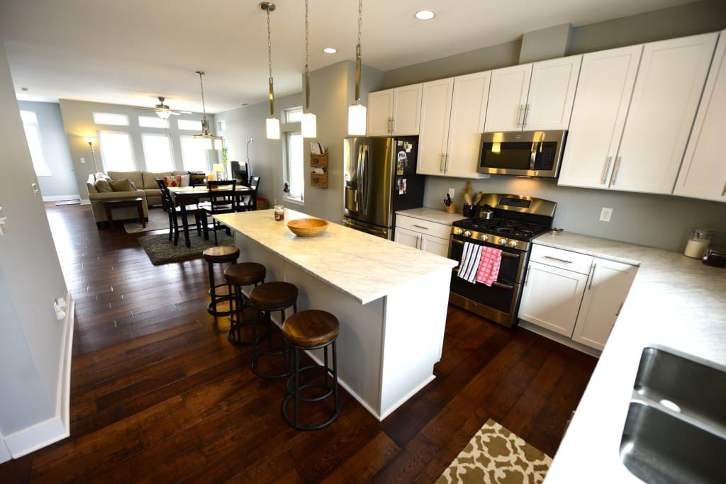 spacious/fully stocked kitchen with bar seating for 4 and huge 5'x5' pantry - brand new stainless steel appliances and carrera marble countertops