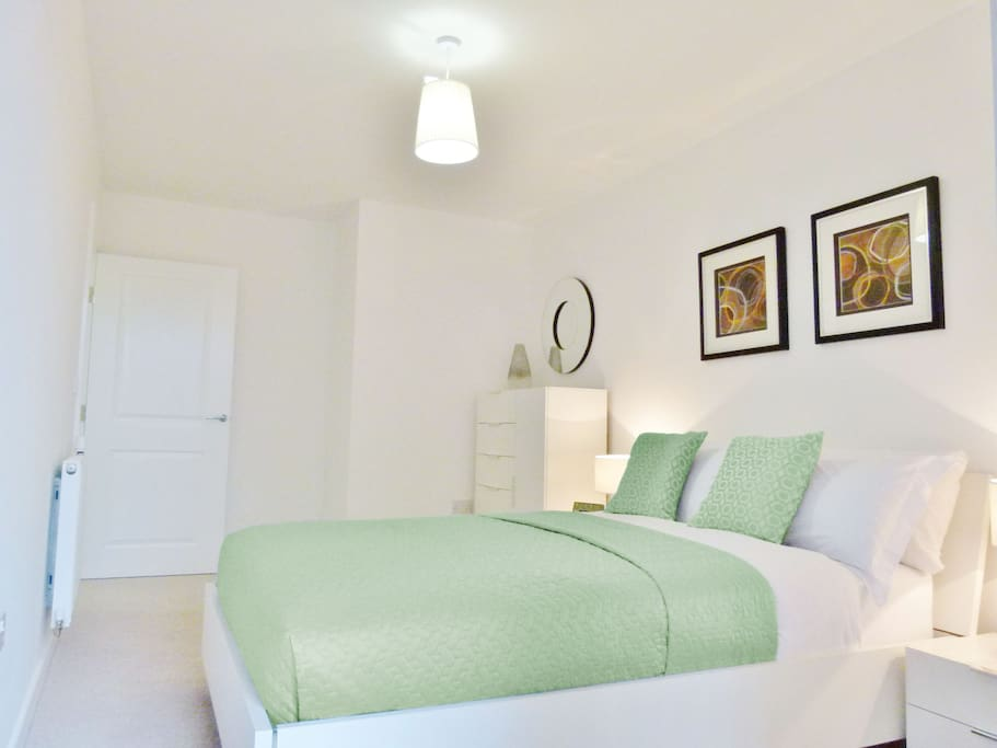 Peaceful, light and airy. This bedroom has a double bed, while a double sofabed is located in the living room.