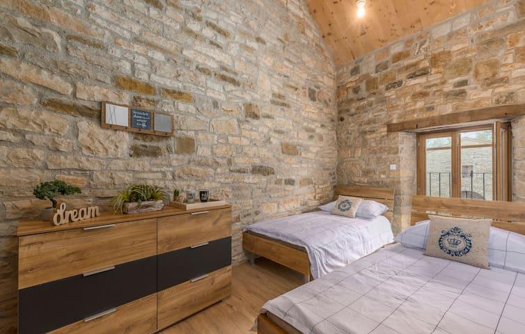 1st floor - Bedroom 2 with single beds.