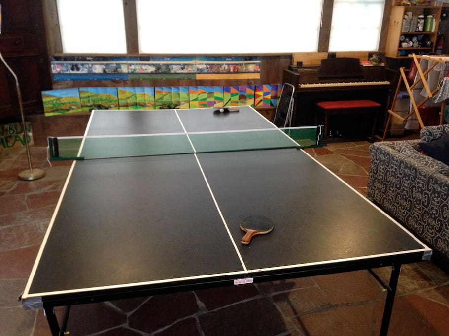 Ping Pong table and piano in the game room